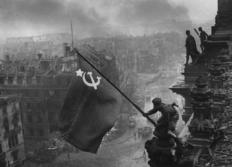 1200px-Raising_a_flag_over_the_Reichstag_(original).jpg